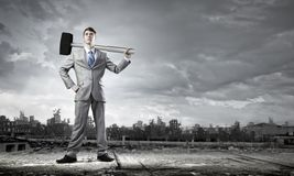 Businessman with hammer Stock Photo