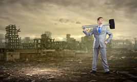 Businessman with hammer Royalty Free Stock Images