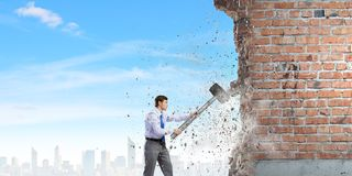 Businessman with hammer Stock Photography