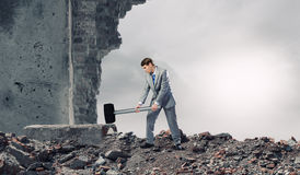Businessman with hammer Royalty Free Stock Photography