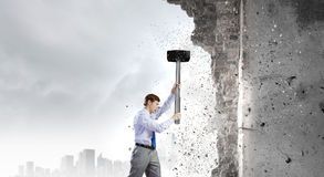 Businessman with hammer Royalty Free Stock Photos
