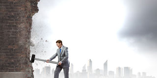 Businessman with hammer Stock Image