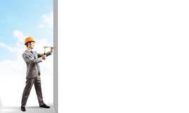 Businessman with hammer Stock Photos