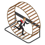 Businessman in a hamster wheel Stock Photo