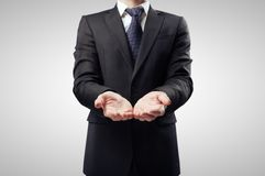 Businessman with hand. Outstretched forward Stock Image