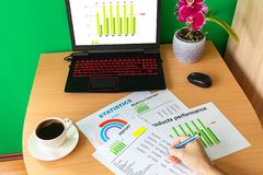 Businessman hand analysing financial report business graphs and charts. Workplace with laptop cup of coffee and graphs - Analysis working report concept stock images