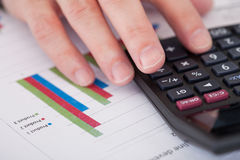 Businessman Hand Analyzing Stock Charts Royalty Free Stock Photo