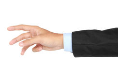 Businessman hand and arm reaching for something Stock Photos
