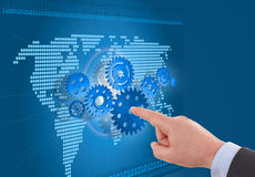 Businessman hand arrange gear on map. royalty free stock photography