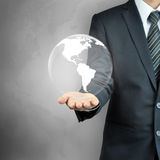 Businessman hand carrying the globe Stock Photography