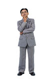 Businessman with hand on chin Royalty Free Stock Photography