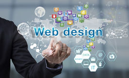 Businessman hand chooses web design wording on interface screen. Internet technology service concept. can used for cover page presentation and web banner Stock Photos