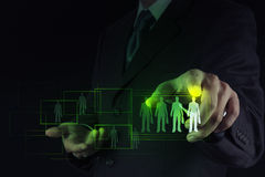 Businessman hand choosing people icon. As human resources concept Stock Image