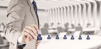 Businessman hand choosing people icon. As human resources concept Stock Photography
