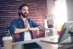 Businessman with hand clasped doing yoga Stock Photo