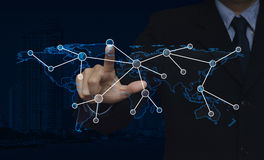 Businessman hand click connection icon with world map over city. Tower background, Elements of this image furnished by NASA stock photo