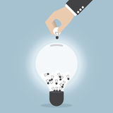 Businessman hand collecting light bulb of idea Royalty Free Stock Photography