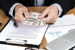 Businessman hand counting money.profit,investment, Royalty Free Stock Photography