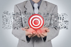 Businessman hand 3d target sign Royalty Free Stock Image