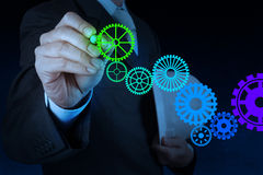 Businessman hand draw leader cog gear to success. Concept royalty free stock images