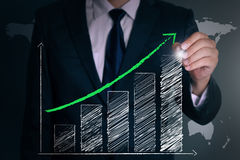 Businessman hand draw a positive graph Stock Photos