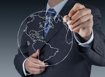 Businessman hand drawing abstract globe Royalty Free Stock Image