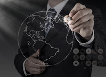 Businessman hand drawing abstract globe Royalty Free Stock Photos