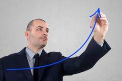 Businessman hand drawing an arrow Stock Image