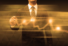 Businessman hand drawing business graph Stock Image