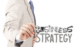 Businessman hand drawing business strategy Royalty Free Stock Images