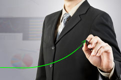 Businessman hand drawing chart green arrow Stock Photo