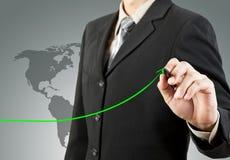 Businessman hand drawing chart green arrow Stock Photos