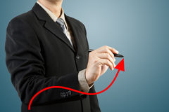 Businessman hand drawing chart red arrow Stock Photos