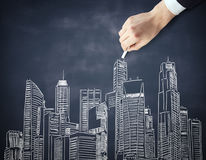 Businessman hand drawing cityscape Stock Photography