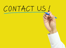 Businessman hand drawing contact us concept Royalty Free Stock Photography