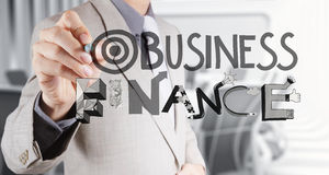 Businessman hand drawing design word Royalty Free Stock Images
