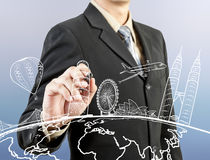 Businessman hand drawing the dream travel around the world Stock Photos