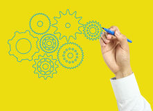 Businessman hand drawing gears Royalty Free Stock Photo