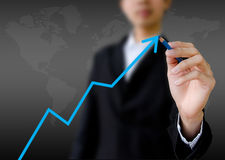 Businessman hand drawing a graph Stock Image