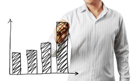 Businessman hand drawing a graph Stock Photo