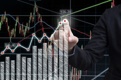 Businessman hand with drawing graph chart and business strategy Royalty Free Stock Images