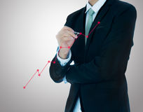 Businessman hand drawing a graph  Royalty Free Stock Image