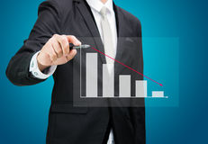 Businessman hand drawing a graph Isolated Stock Photography