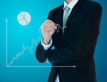 Businessman hand drawing a graph Isolated Royalty Free Stock Images