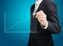 Businessman hand drawing a graph Isolated Stock Images