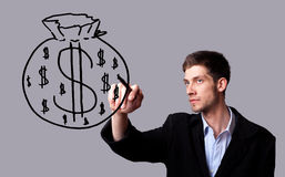 Businessman hand drawing and idea for making money Royalty Free Stock Photography