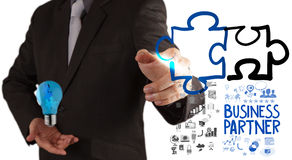 Businessman hand drawing Partnership Puzzle Stock Images