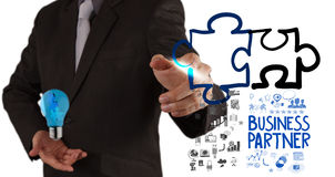 Businessman hand drawing Partnership Puzzle Stock Photos
