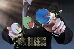 Businessman hand drawing a pie chart Royalty Free Stock Photos