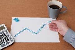 Businessman hand drawing a progress graph Stock Photography